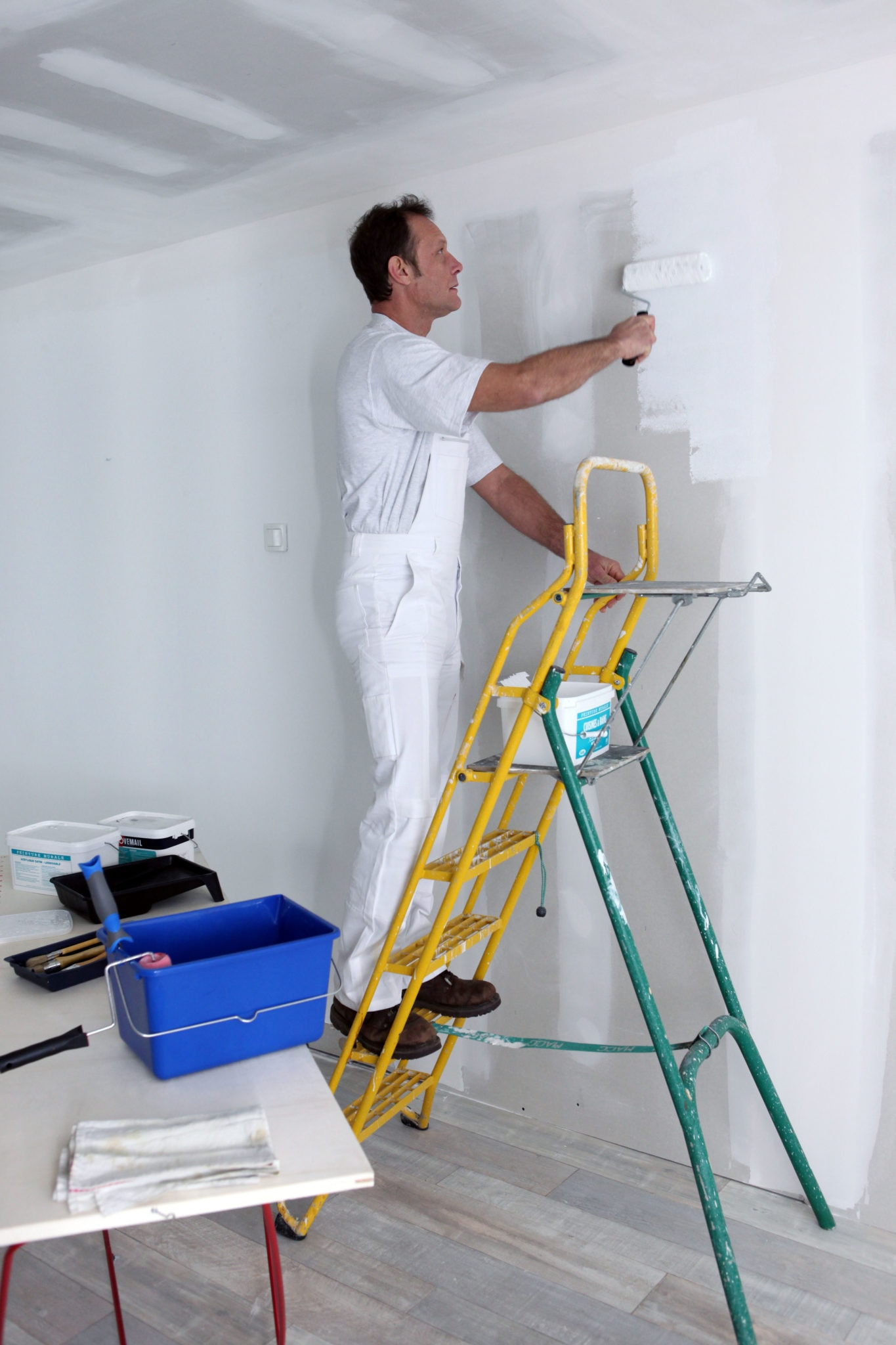 Commercial painting can include both interior and exterior surfaces. Interior walls are prepared and primed before applying paint.